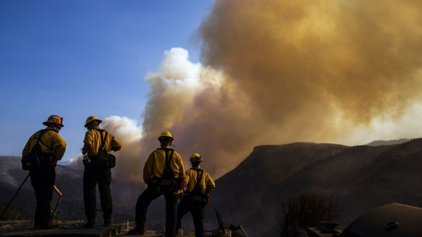 LOS ANGELES, CALIF. - NOVEMBER 11: Fire Fighters working to put out hotspots in and around structure