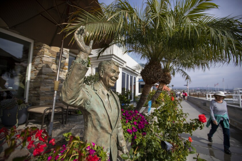 A statue of former President Ronald Reagan, an icon of Republican politics, adorns a Balboa Island waterfront home in Newport Beach in October.