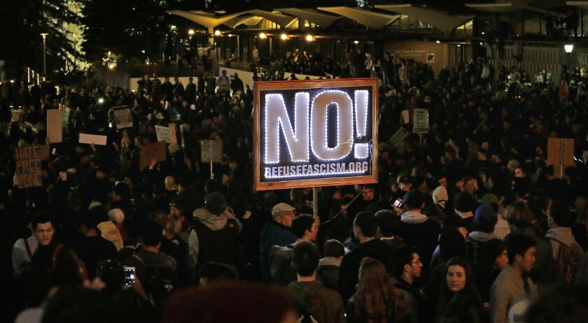 Demonstrators protest at UC Berkeley's Sproul Plaza against a scheduled appearance by Breitbart's Milo Yiannopoulos.