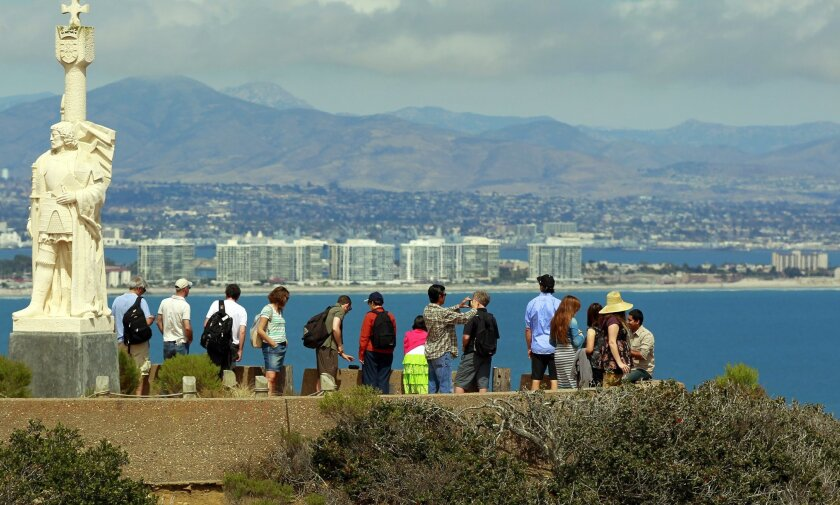 Guests at the  Cabrillo National Monument take in a view of Coronado and the hills above Otay Ranch on a clear day this past summer.