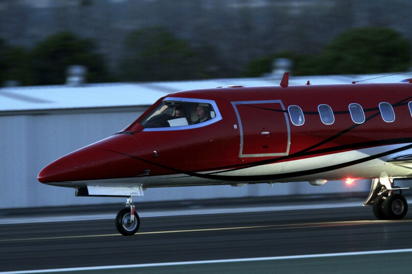 A private jet heads down the runway at Santa Monica Airport.