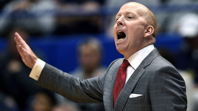 Cincinnati coach Mick Cronin calls a play from the sideline against Connecticut on Feb. 24 at XL Center.