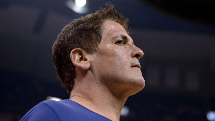 Dallas Mavericks owner Mark Cuban walks off the court after the first half of a game against Memphis on April 12.