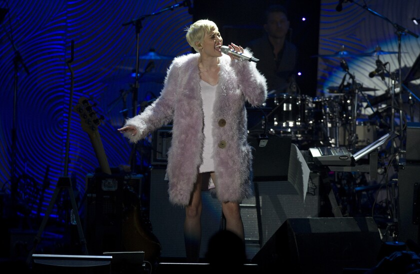 Miley Cyrus performs Saturday during Clive Davis' annual pre-Grammy Awards gala at the Beverly Hilton Hotel.