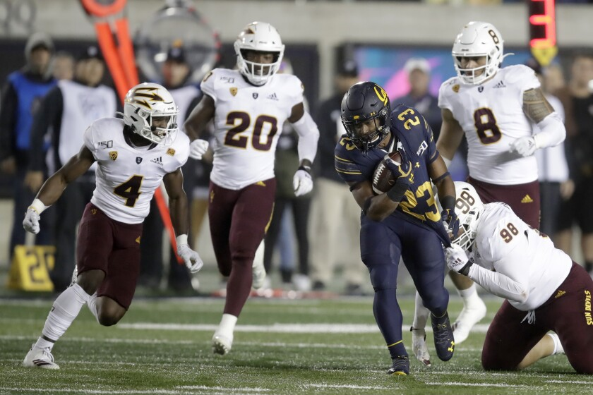 California's Marcel Dancy (23) evades the tackle of Arizona States' D.J. Davidson, right, in the first half on Friday in Berkeley.