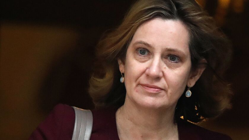 File - In this Wednesday, March 14, 2018 file photo Britain's Home Secretary Amber Rudd leaves 10 Do