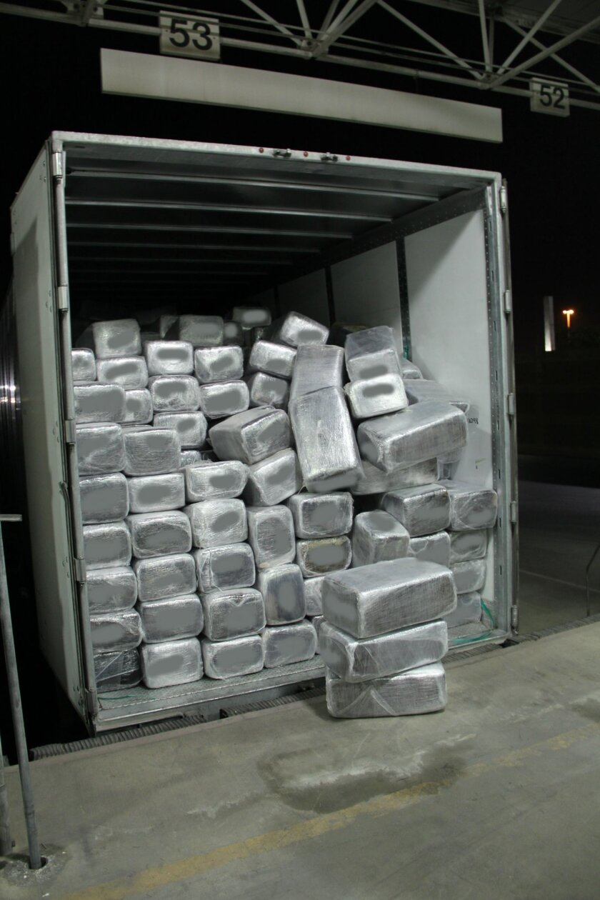 The trailer was stacked with nearly 1,300 packages of marijuana. / U.S. Customs and Border Protection