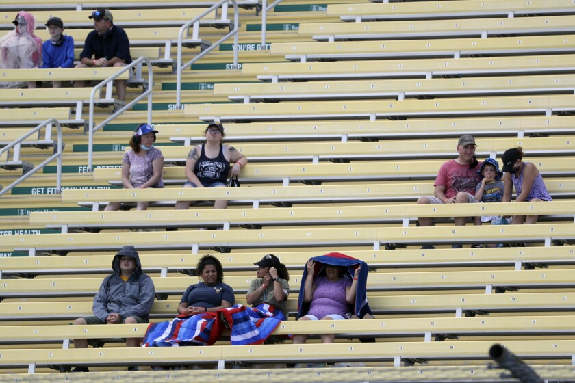 Fans wait for the start of a NASCAR Cup Series auto race Sunday, June 14, 2020, in Homestead, Fla. Up to 1,000 area military members and guests were allowed in to watch the race. (AP Photo/Wilfredo Lee)
