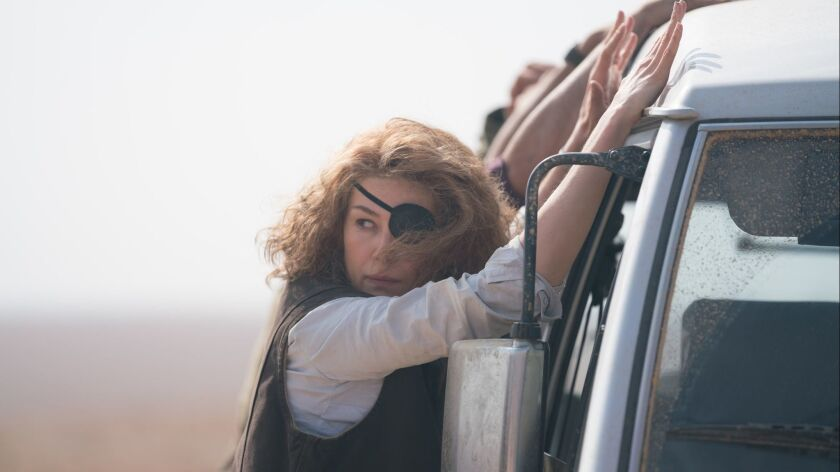 "Marie Colvin (Rosamund Pike) is caught between borders in ""A PRIVATE WAR."" Credit: Keith Bernstein/"