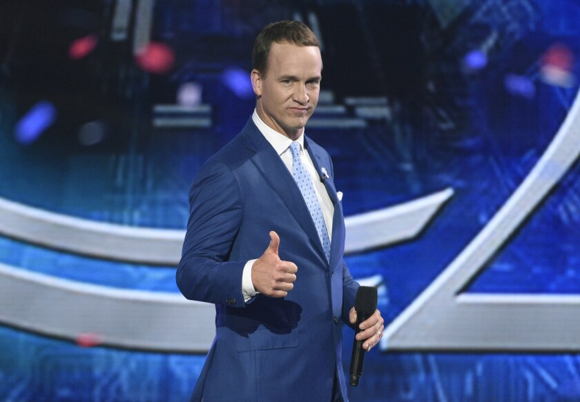 Peyton Manning gives a thumbs up as he delivers some sharp one-liners while hosting the ESPY Awards in 2017.