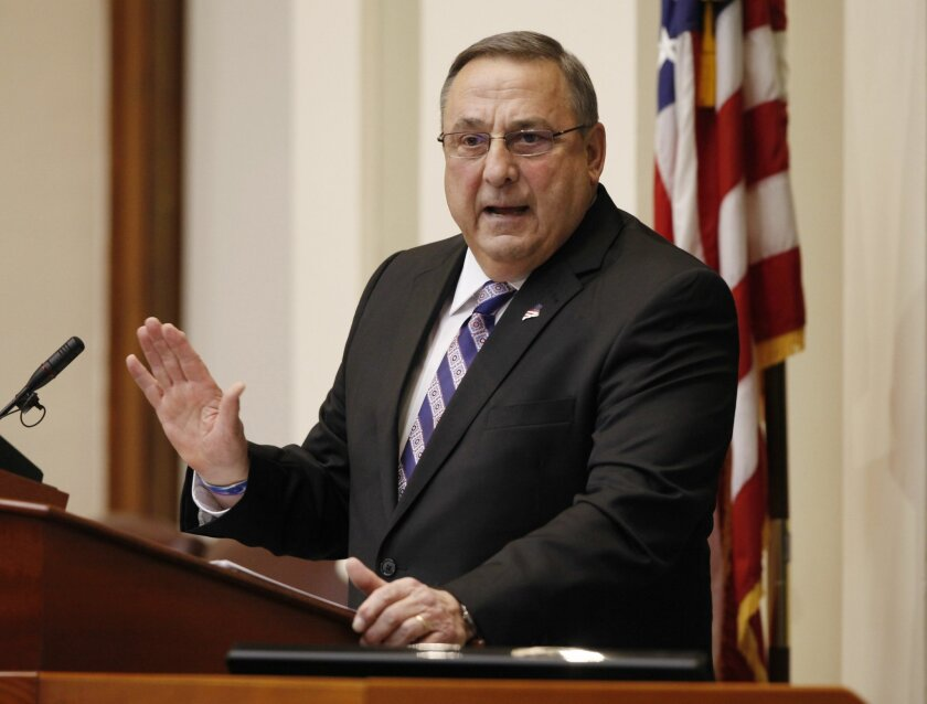 FILE - In this Feb. 3, 2015 file photo, Gov. Paul LePage delivers his State of the State address to the Legislature at the Statehouse in Augusta, Maine. Maine's governor has threatened to call up the National Guard to fight an epidemic of heroin and other drugs if lawmakers don't hire more agents.
