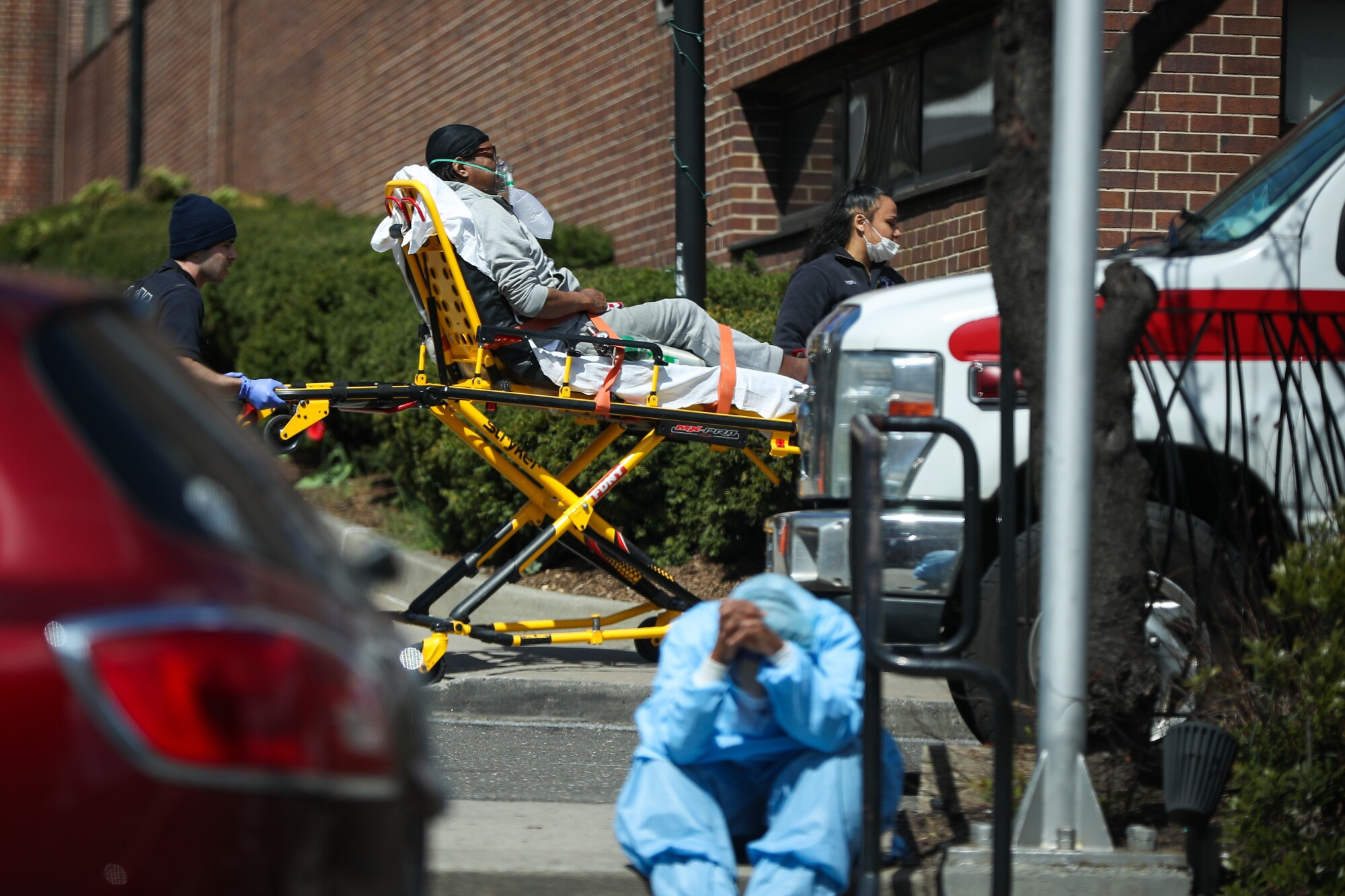 A tired healthcare worker by the Brooklyn Hospital Center in New York.