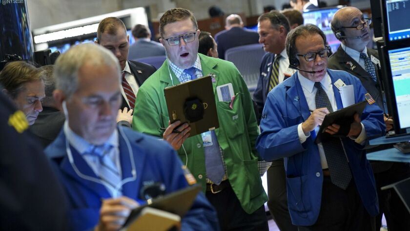 Traders and financial professionals work on the floor of the New York Stock Exchange.