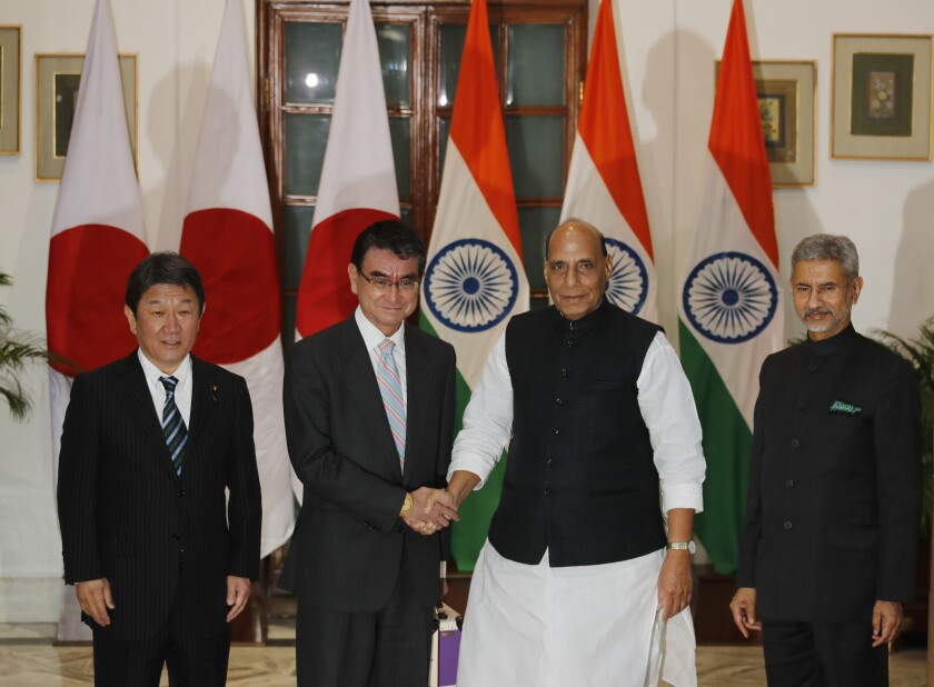 Indian Defense Minister Rajnath Singh, second right, Japanese Defense Minister Taro Kono, second left, Indian Foreign Minister S. Jaishankar, right, and Japanese counterpart Toshimitsu Motegi pose for the media before the start of India Japan 2+2 talks, in New Delhi, India, Saturday, Nov. 30, 2019, to boost bilateral security and Defence cooperation between the two countries. (AP Photo/Manish Swarup)