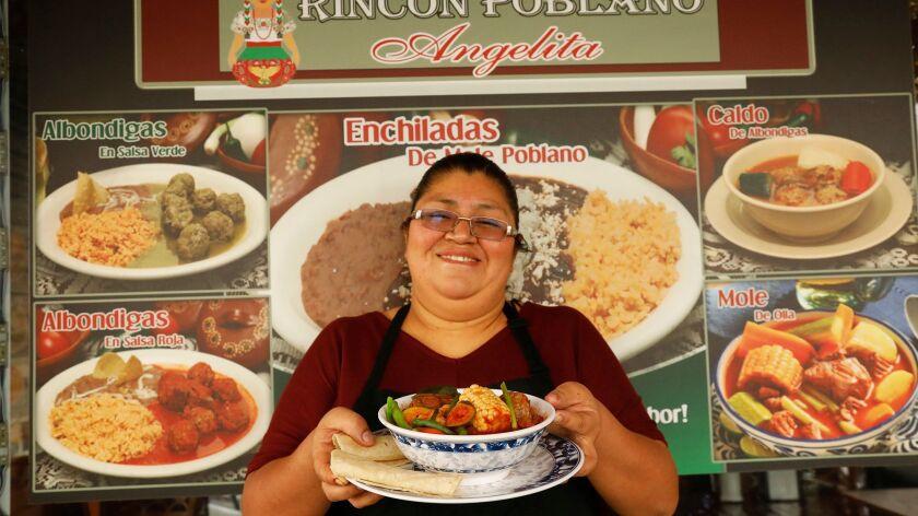 LOS ANGELES, CA - DECEMBER 20, 2017 -- Lourdes Romero holds a bowl of Mole de Olla at the Rincon Pob