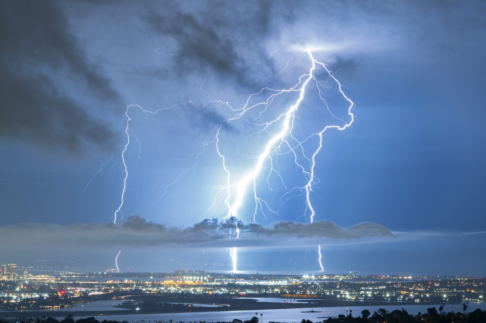 Lighting strikes the ground near Coronado as seen from Mt. Soledad during a lighting storm.
