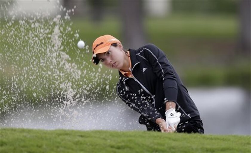 Carlota Ciganda, of Spain hits, out of the sand on the eighth hole during the second round of the North Texas LPGA Shootout golf tournament Friday, April 26, 2013, at Los Colinas Country Club in Irving, Texas. (AP Photo/LM Otero)