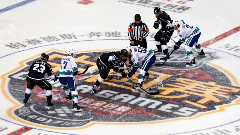 buy popular c0ae3 a5e06 Kings defeat Canucks in first NHL game played in China - Los ...