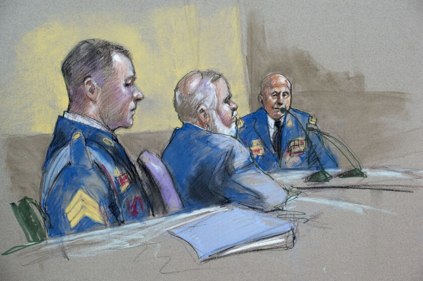 Army Sgt. Bowe Bergdahl, left, and defense lead counsel Eugene Fidell, center, look on as Maj. Gen. Kenneth Dahl is questioned at a preliminary hearing.