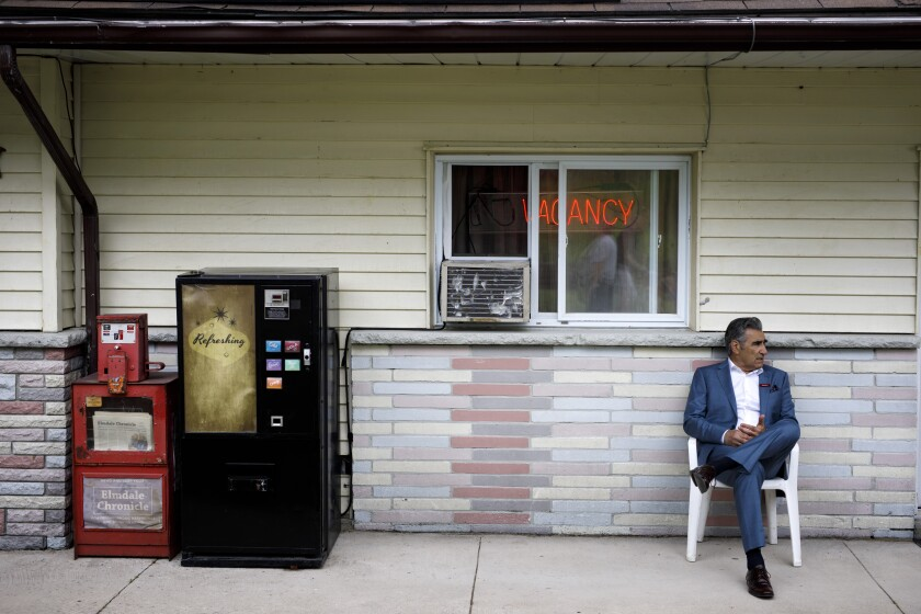 """Actor Eugene Levy waits between takes on the set of """"Schitt's Creek"""" in Hockley Valley, Canada, during one of the series' final filming days last summer."""