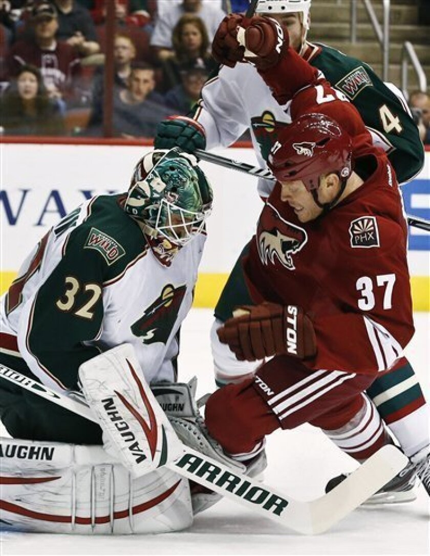 Phoenix Coyotes' Raffi Torres (37) collides with Minnesota Wild's Niklas Backstrom (32), of Finland, during the first period in an NHL hockey game, Thursday, Feb. 28, 2013, in Glendale, Ariz. (AP Photo/Ross D. Franklin)