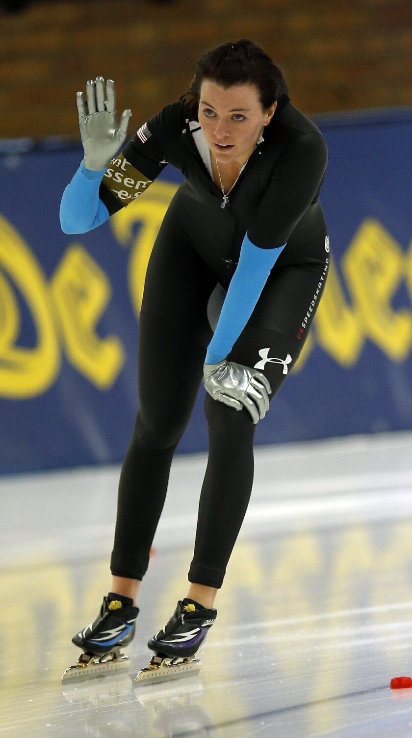 First placed Heather Richardson from the US celebrates after the Women's 1,000 meters race of the speed skating World Cup, in Berlin, Germany, Sunday, Dec. 8, 2013. (AP Photo/Michael Sohn)