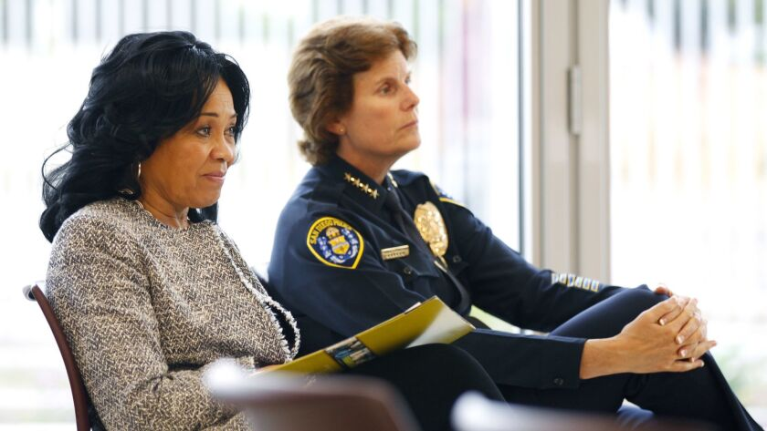 San Diego City Council President Myrtle Cole, left, and Police Chief Shelley Zimmerman listen during