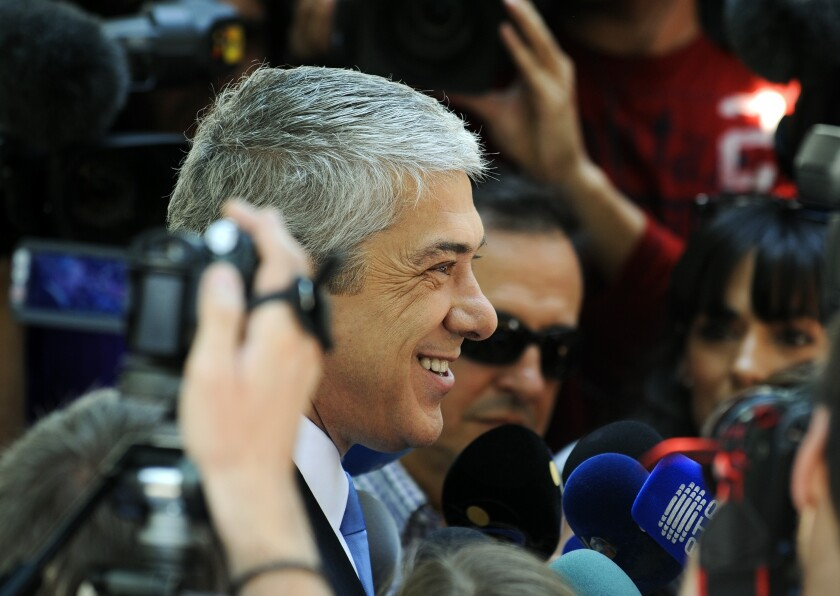 FILE - In this Sunday, June 5, 2011 file photo, Portugal's interim Prime Minister and Socialist Party leader Jose Socrates talks to journalists after voting in Portugal's general elections, in Lisbon. A Lisbon judge is due to rule Friday, April 9, 2021 whether evidence gathered by public prosecutors is sufficient to put former Portuguese prime minister José Sócrates on trial for alleged corruption, money laundering and tax fraud. Prosecutors allege that Sócrates pocketed around 34 million euros ($40 million) during and after his six years in office between 2005 and 2011. Sócrates, who was a center-left Socialist prime minister, has denied any wrongdoing. (AP Photo/Paulo Duarte, FIle)