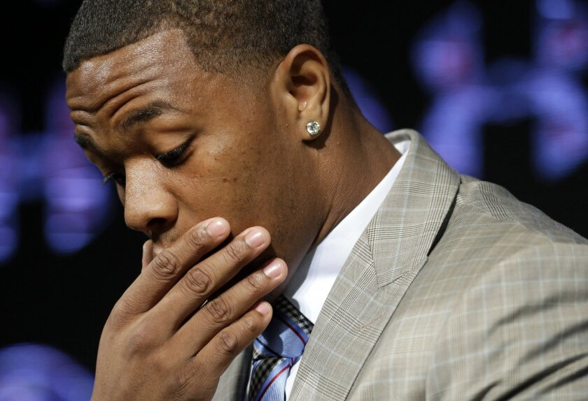 FILE - In this May 23, 2014, file photo, Baltimore Ravens running back Ray Rice pauses as he speaks during a news conference at the team's practice facility in Owings Mills, Md. A new video that appears to show Ray Rice striking then-fiance Janay Palmer in an elevator last February has been release