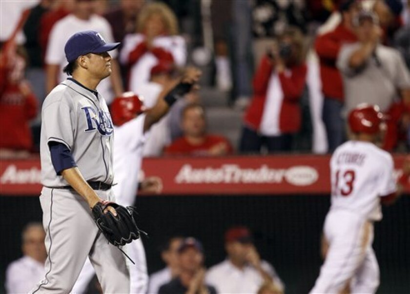 Tampa Bay Rays relief pitcher Cesar Ramos walks back to the mound after giving up three run to the Los Angeles Angels during the eighth inning of a baseball game in Anaheim, Calif., Wednesday, June 8, 2011. (AP Photo/Chris Carlson)