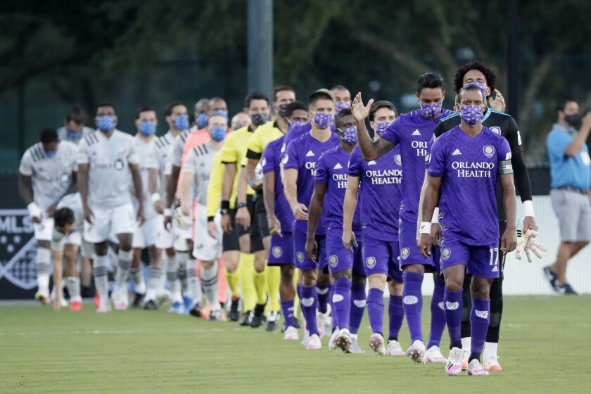 Orlando City and Montreal take to the field wearing masks before their July 25 game.