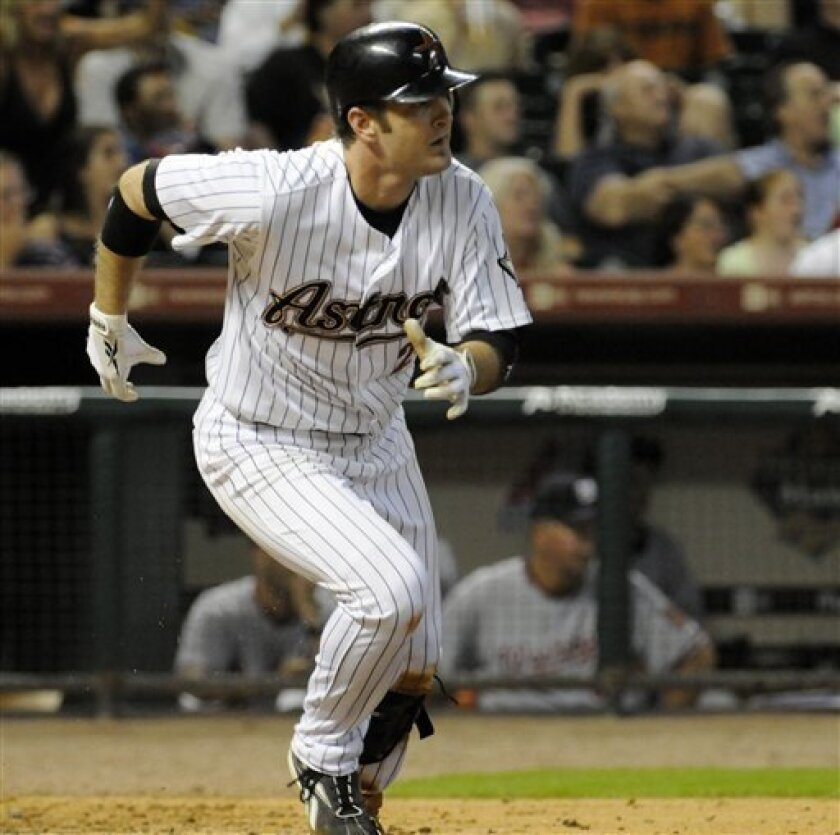 Houston Astros' Jeff Keppinger races down the first base line after hitting a two-run triple to tie up the game in the sixth inning against the Washington Nationals in a baseball game in Houston, Thursday, July 9, 2009. (AP Photo/Pat Sullivan)