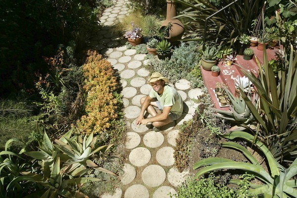 """At a time when people are serious about responsible gardening, James Duell's small-scale garden, essentially a path next to his rented back house in Culver City, is a reminder that you don't need a lot of space or water to create a wonderful garden experience. The scale is small, but the effect is inspiring and surprising, given his unusual plant choices. """"The best gardens serve a higher purpose than themselves,"""" says the designer, who has worked on the grounds of the Norton Simon Museum in Pasadena. """"There is so much at stake now. Especially in this part of the world. There are magnificent gardens to be created using succulents and drought-tolerant plants."""""""