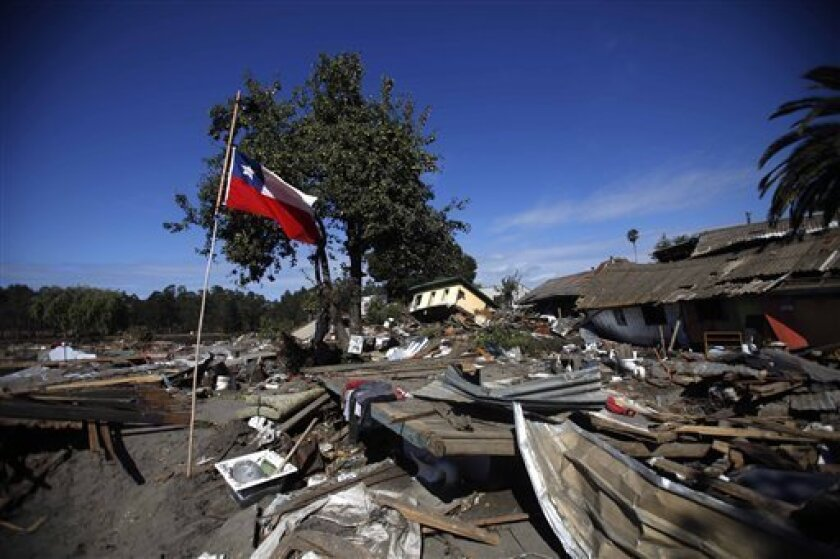 A Chilean flag waves at an earthquake area in Constitucion, Chile, Tuesday, March 2 , 2010. An 8.8-magnitude earthquake hit Chile early Saturday, causing widespread damage. (AP Photo/ Roberto Candia)
