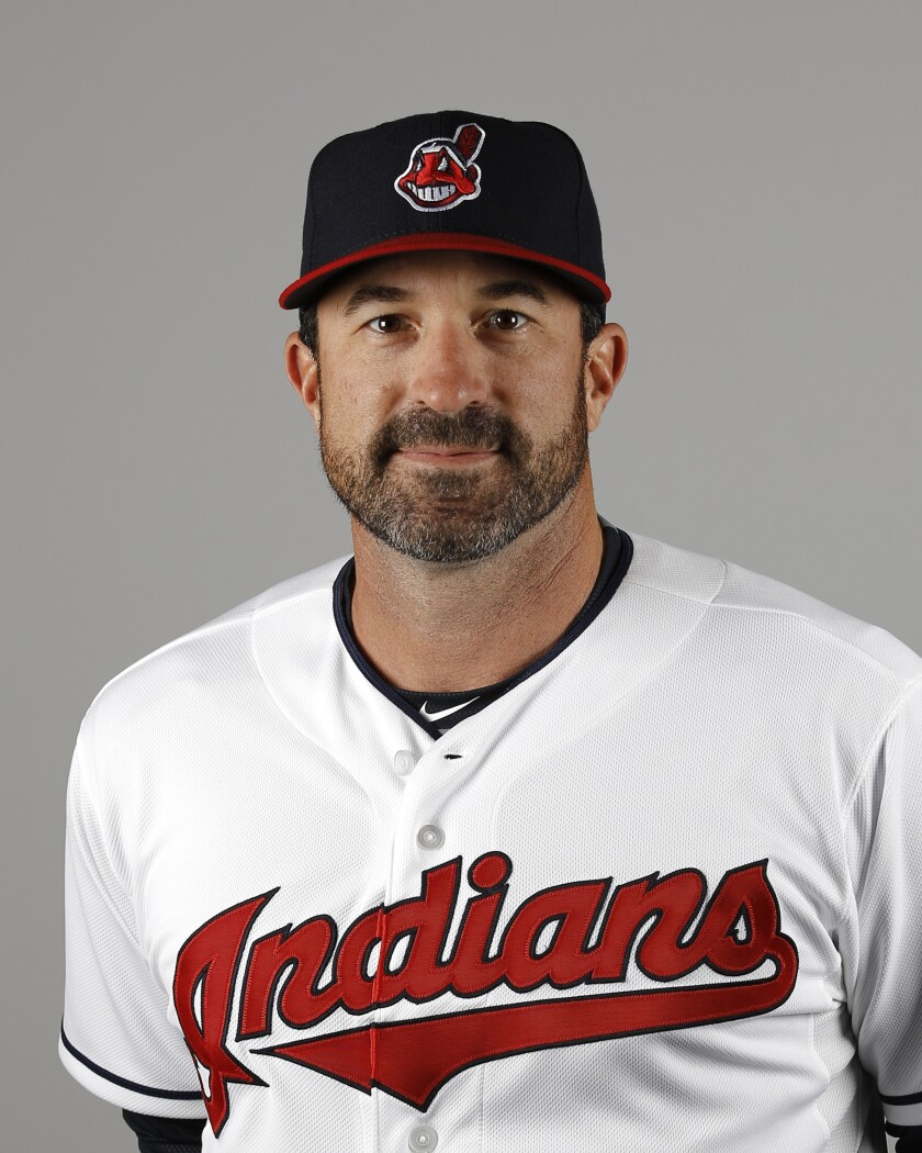 FILE - This is a 2016 file photo showing Mickey Callaway of the Cleveland Indians baseball team. Indians president of baseball operations Chris Antonetti said he couldn't comment on previous remarks made about Mickey Callaway's behavior due to Major League Baseball's ongoing investigation into allegations the team's former pitching coach sexually harassed women. Antonetti joined manager Terry Francona for his Zoom availability on Wednesday, March 3, 2021, a day after a story by The Athletic said several former Indians employees had come forward in the last month to say the team's front office was aware of Callaway's actions. (AP Photo/Morry Gash, File)