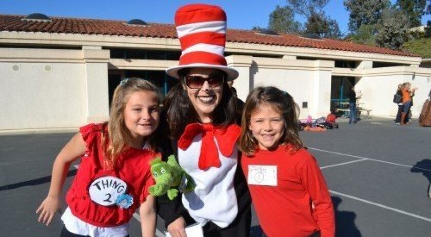 """Thing 1,"" Faith Bonano, and ""Thing 2,"" Sophia Vierling, with SSF's curriculum resource teacher Veronica Reist dressed as the ""Cat in the Hat"""