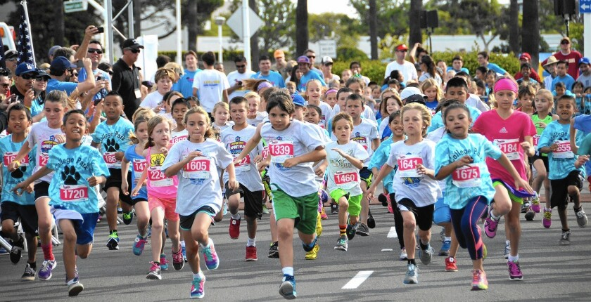 Eight-year-olds join the 32nd annual Newport-Mesa Spirit Run, a fundraiser for participating schools.