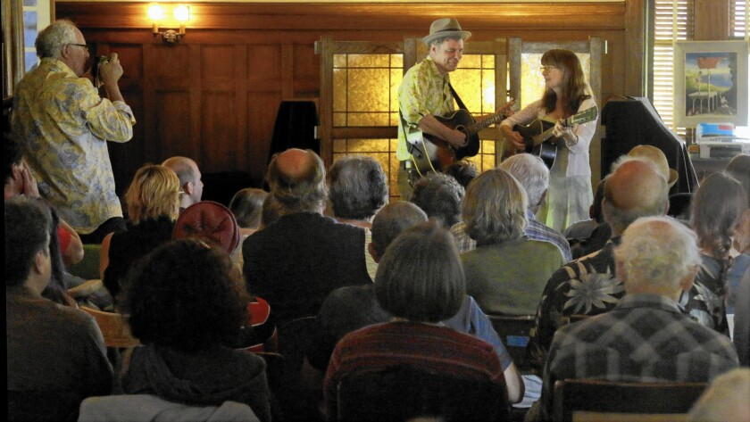 Musicians John Grimm and Beverly Smith perform before an audience in the living room at David Bunn's farmhouse in the Santa Paula area on May 24, 2015.