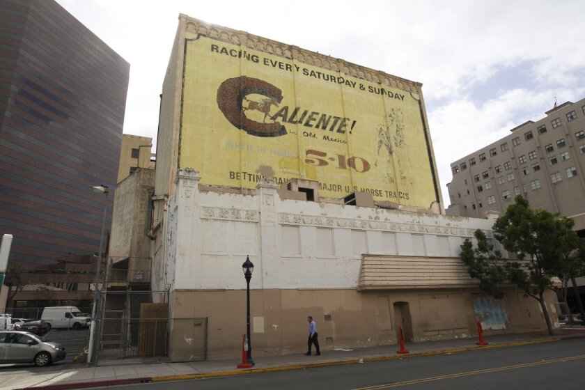 The fate of a large painted billboard advertising horse racing at Tijuana's Caliente race track on the west side of the now closed and historically designated California Theater downtown and at least one other sign are up for a vote on Thursday, pitting preservationists against developers.