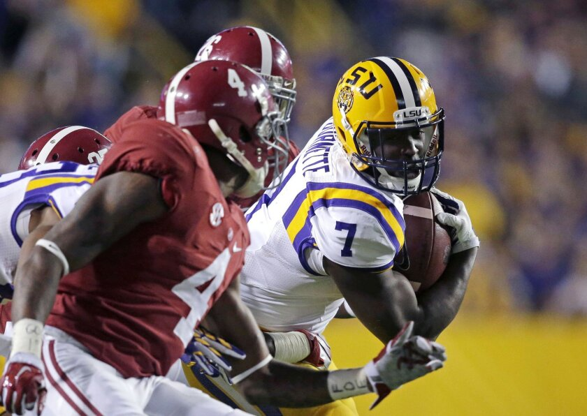 FILE - In this Nov. 8, 2014, file photo, LSU running back Leonard Fournette (7) carries in the first half of an NCAA college football game against Alabama in Baton Rouge, La. One of the best fronts in the country takes on the nation's leading rusher and Heisman Trophy candidate when Alabama and LSU