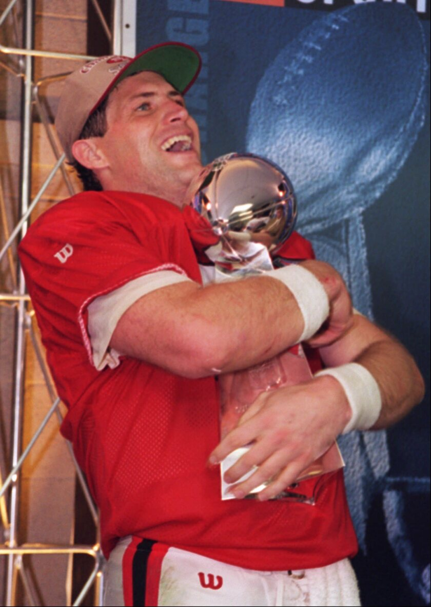 San Francisco 49ers quarterback Steve Young (8) hugs the Lombardi Trophy on Jan. 29, 1995. Young led the 49ers to a 49-26 victory over the San Diego Chargers in Super Bowl XXIX.