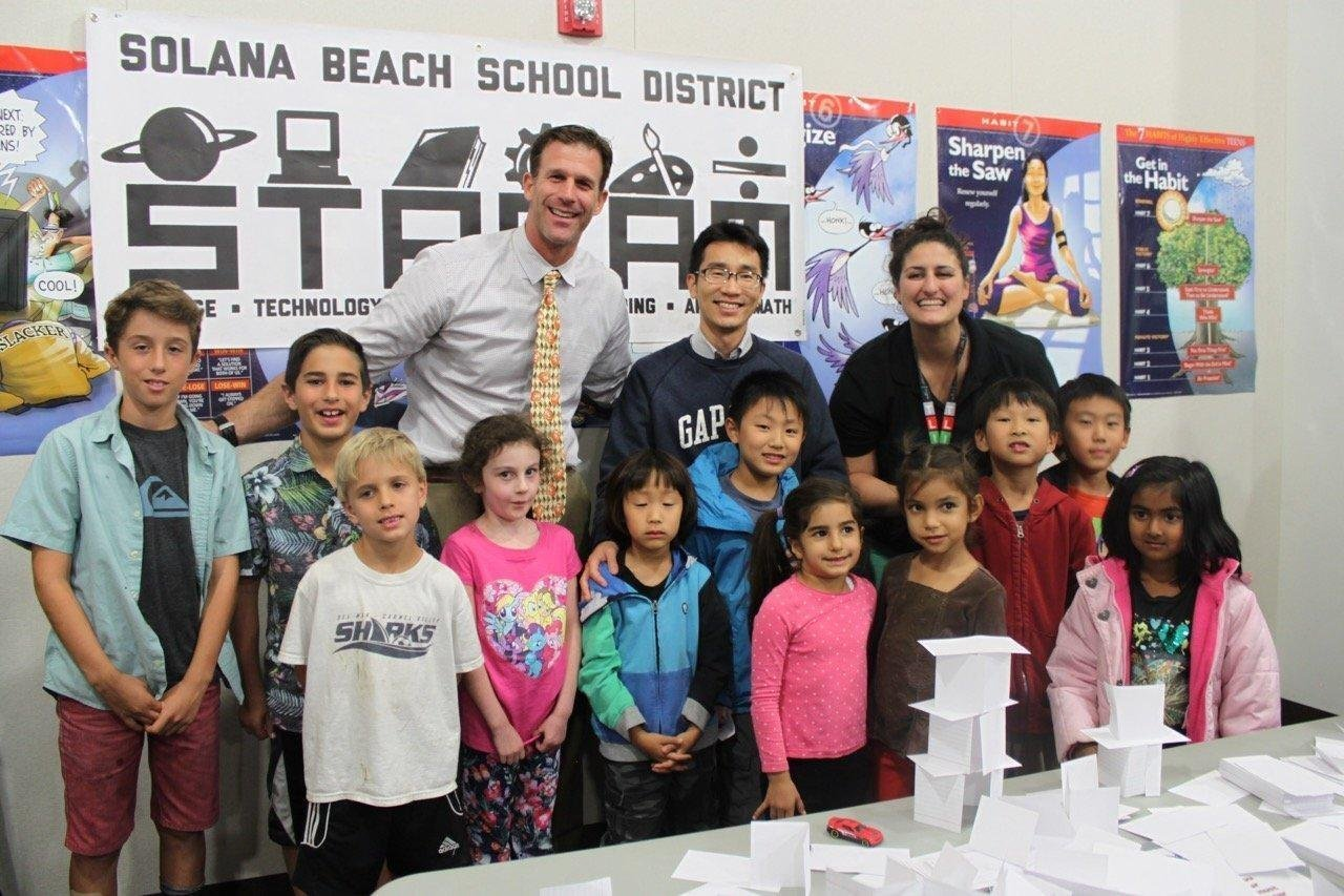 Principal Mr. Jones, Solana Ranch parent, Jojo Piranio and students.