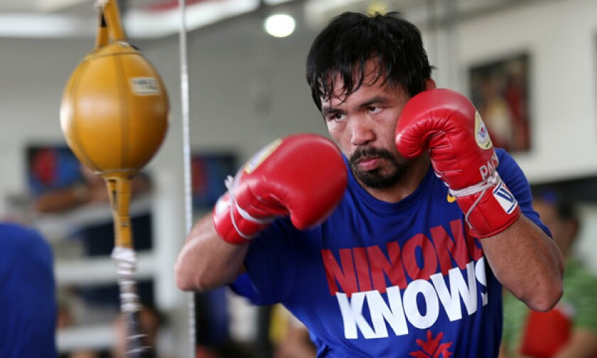 Manny Pacquiao takes part in a training session in the Philippines. Pacquaio will fight Timothy Bradley for the WBO welterweight title on April 12.