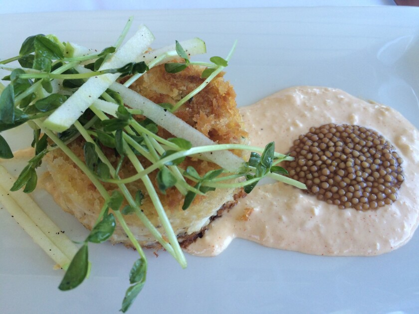 Don't miss the bluefin lump crab cake, with smoked onion remoulade, pickled mustard seeds and pea shoots, at Top of the Market.
