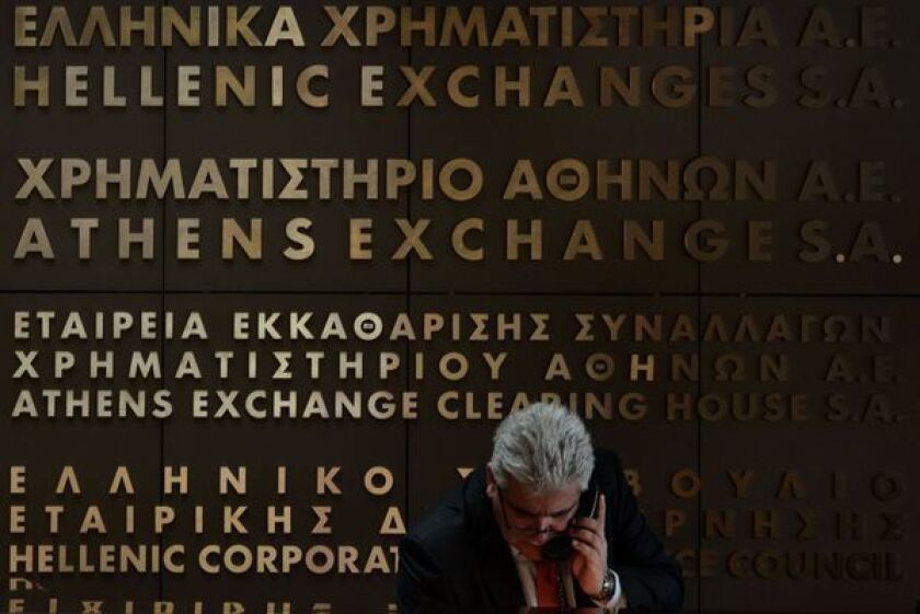 An employee of the Athens stock exchange talks on the phone.