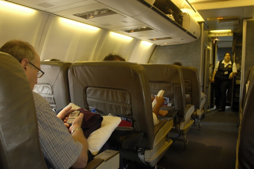 Americans are expected to spend more on business travel in 2014 than last year, according to a forecast by a travel trade group. Above, the first-class cabin on an American Airlines jetliner in March 2006.
