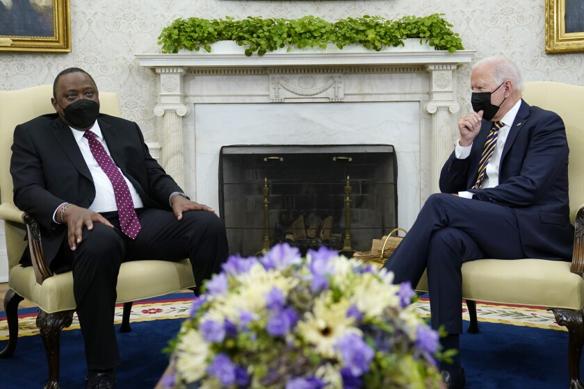 President Joe Biden, right, listens as Kenyan President Uhuru Kenyatta, left, speaks during their meeting in the Oval Office of the White House in Washington, Thursday, Oct. 14, 2021. (AP Photo/Susan Walsh)