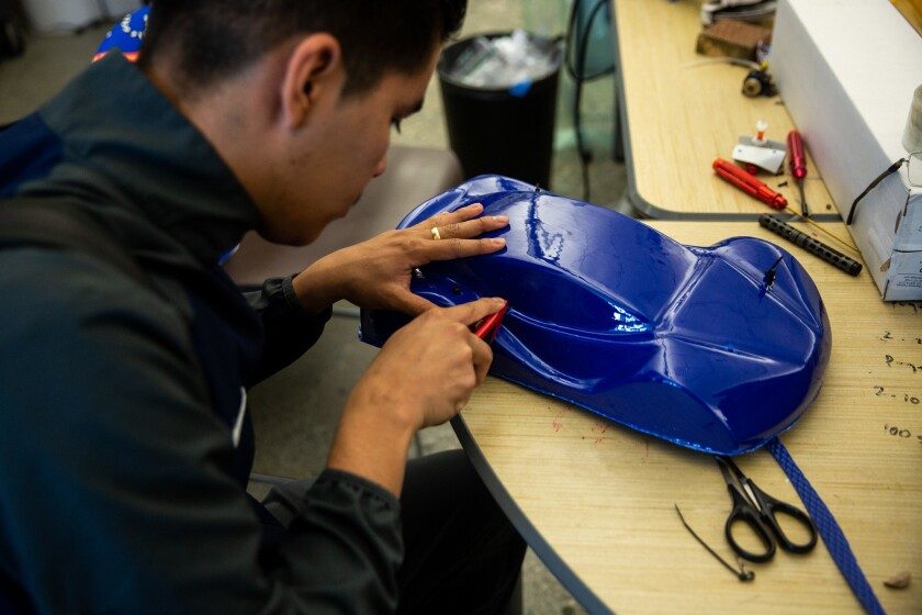 SOUTH GATE, CALIF. - MAY 29: Ismael Zenteno, 17, of South Gate, works on the shell of a hydrogen pow