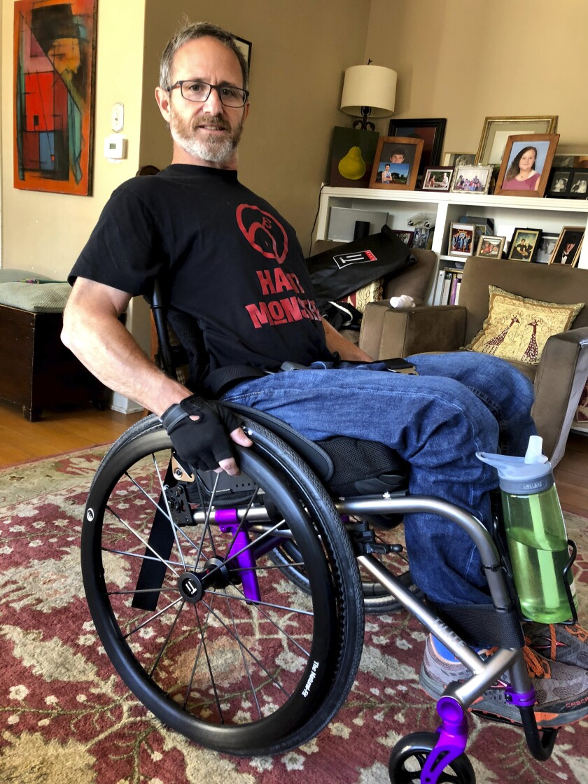 In this May 15, 2018 photo, Samuel Kolb poses for a photo in San Mateo, Calif. A Northern California county has agreed to pay nearly $10 million to settle a lawsuit by Kolb, who was going through a severe epileptic episode when a deputy shot him in the abdomen, paralyzing him from the waist down. (Karin Kolb via AP)
