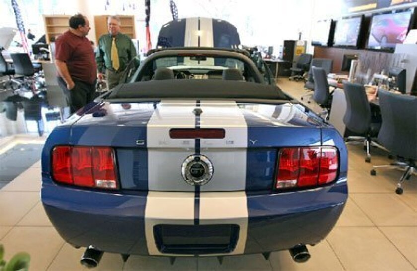 A customer looked at a Mustang yesterday at San Francisco  Ford. The automaker reported a $5.9 billion quarterly loss,  twice what it lost in the same quarter of 2007.  (Getty Images)